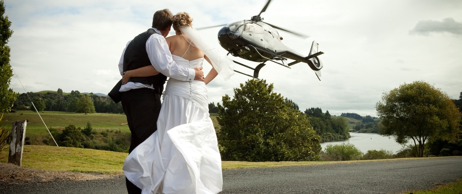Husband & Wife Looking at Helicopter